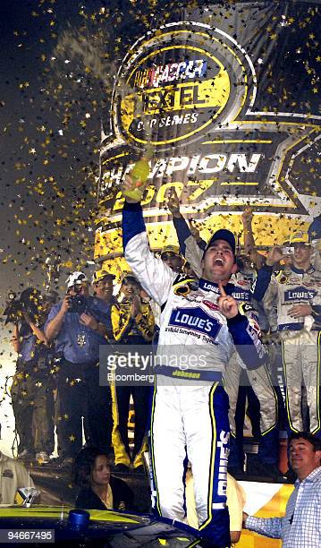 Nextel Cup winner Jimmie Johnson celebrates his back to back Nextel Cup championship in victory lane following the Ford 400 NASCAR race at the...