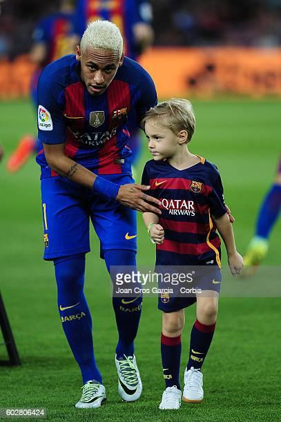 Neyma with his son, Davi Lucca da Silva Santos attend the Spanish League match between F.C Barcelona vs Deportivo Alavés at Nou Camp, on September,...