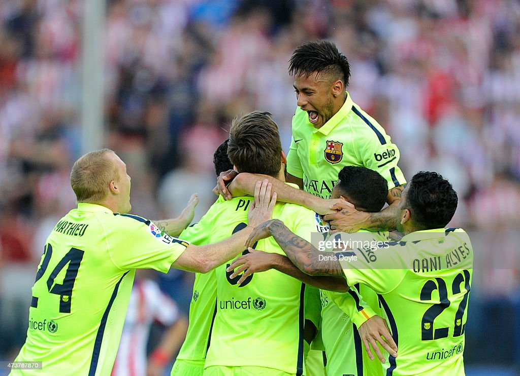 Neyman of FC Barcelona jumps on top of teammates after winning the La Liga at the end of the La Liga match between Club Atletico de Madrid and FC Barcelona at Vicente Calderon Stadium on May 17, 2015 in Madrid, Spain.