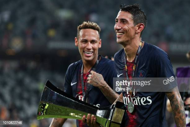 Neymar and Angel Di Maria of Paris SaintGermain celebrate with trophy after winning the French Trophy of Champions football match between AS Monaco...