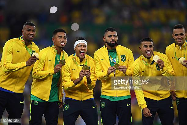 Neymar and Brazilian team mates celebrate with their gold medals after winning the Men's Football Final between Brazil and Germany at the Maracana...
