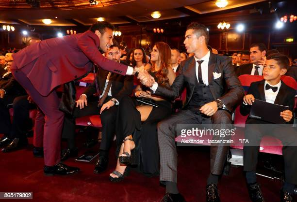 Neymar and Cristiano Ronaldo greet each other during The Best FIFA Football Awards at The May Fair Hotel on October 23 2017 in London England