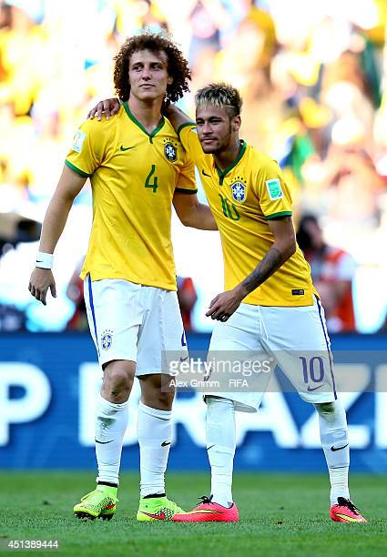 Neymar and David Luiz of Brazil celebrate the win after the 2014 FIFA World Cup Brazil Round of 16 match between Brazil and Chile at Estadio Mineirao...