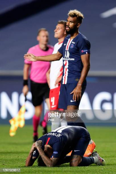 Neymar and Eric Maxim Choupo-Moting of Paris Saint-Germain react to the final whistle after the UEFA Champions League Semi Final match between RB...