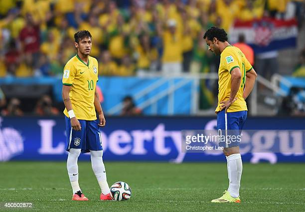 Neymar and Fred of Brazil wait to kick off in the first half during the 2014 FIFA World Cup Brazil Group A match between Brazil and Croatia at Arena...