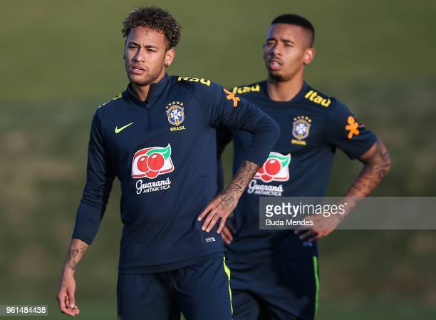 Neymar and Gabriel Jesus look on during a training session of the Brazilian national football team at the squad's Granja Comary training complex on...
