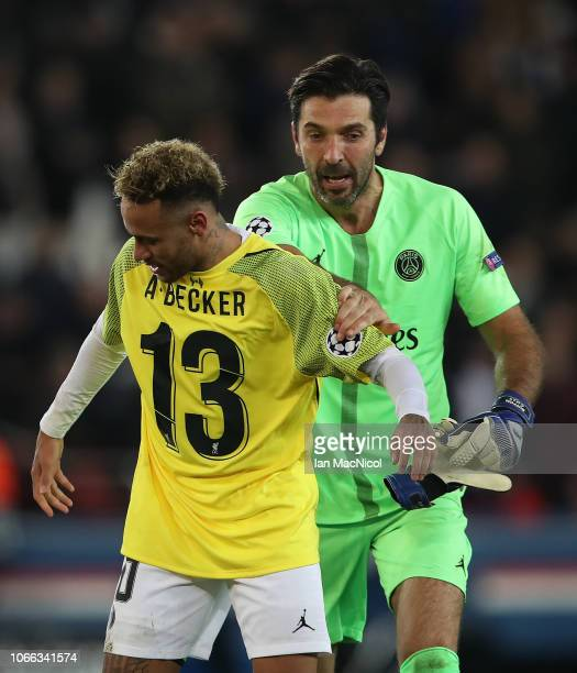 Neymar and Gianluigi Buffon of Paris SaintGermain celebrate during the Group C match of the UEFA Champions League between Paris SaintGermain and...