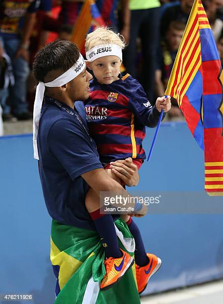 Neymar and his son David Lucca da Silva Santos celebrate the victory after the UEFA Champions League Final between Juventus Turin and FC Barcelona at...