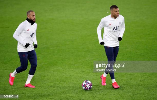 Neymar and Kylian Mbappe attend the training session of Paris SaintGermain ahead of their UEFA Champions League round of 16 match between Borussia...