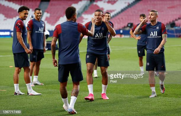 Neymar and Kylian Mbappe of Paris Saint-Germain interact during a training session ahead of their UEFA Champions League Final match against Bayern...