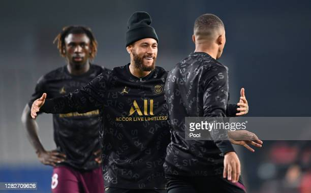 Neymar and Kylian Mbappe of Paris SaintGermain laugh during warm ups prior to the UEFA Champions League Group H stage match between Istanbul...