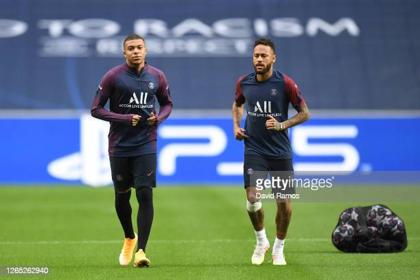 Neymar and Kylian Mbappe of PSG look on during the PSG Training Session ahead of the UEFA Champions League Quarter Final match between Atalanta and...