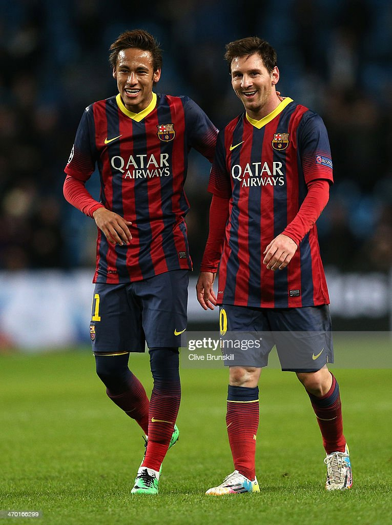 Neymar (L) and Lionel Messi of Barcelona walk off in good spirits following their team's victory at the end of the UEFA Champions League Round of 16 first leg match between Manchester City and Barcelona at the Etihad Stadium on February 18, 2014 in Manchester, England.