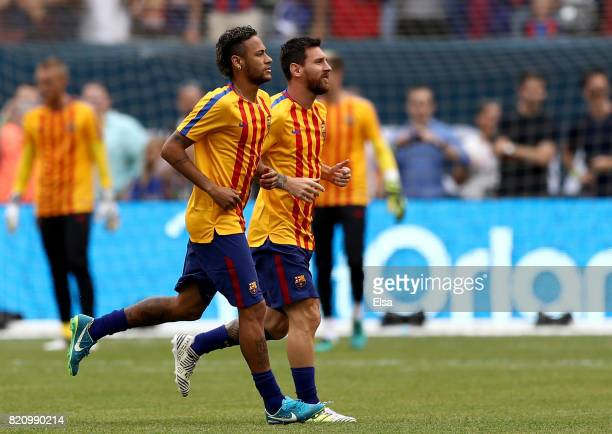 Neymar and Lionel Messi of Barcelona warm up before the International Champions Cup 2017 on July 22 2017 at MetLife Stadium in East Rutherford New...