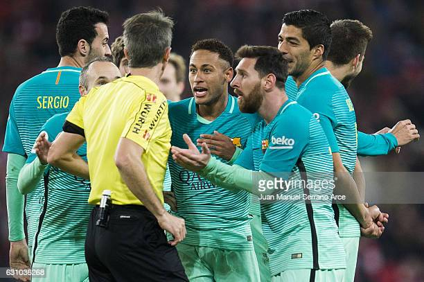 Neymar and Lionel Messi of FC Barcelona argues with referee Feranandez Borbalan during the Copa del Rey Round of 16 first leg match between Athletic...