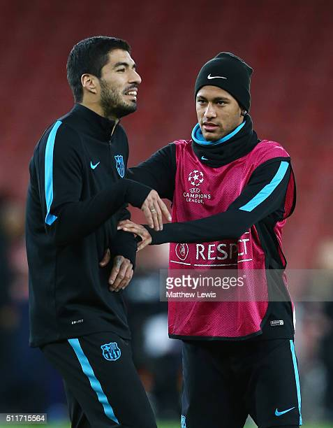 Neymar and Luis Suarez look on during a FC Barcelona training session ahead of their UEFA Champions League round of 16 first leg match against...