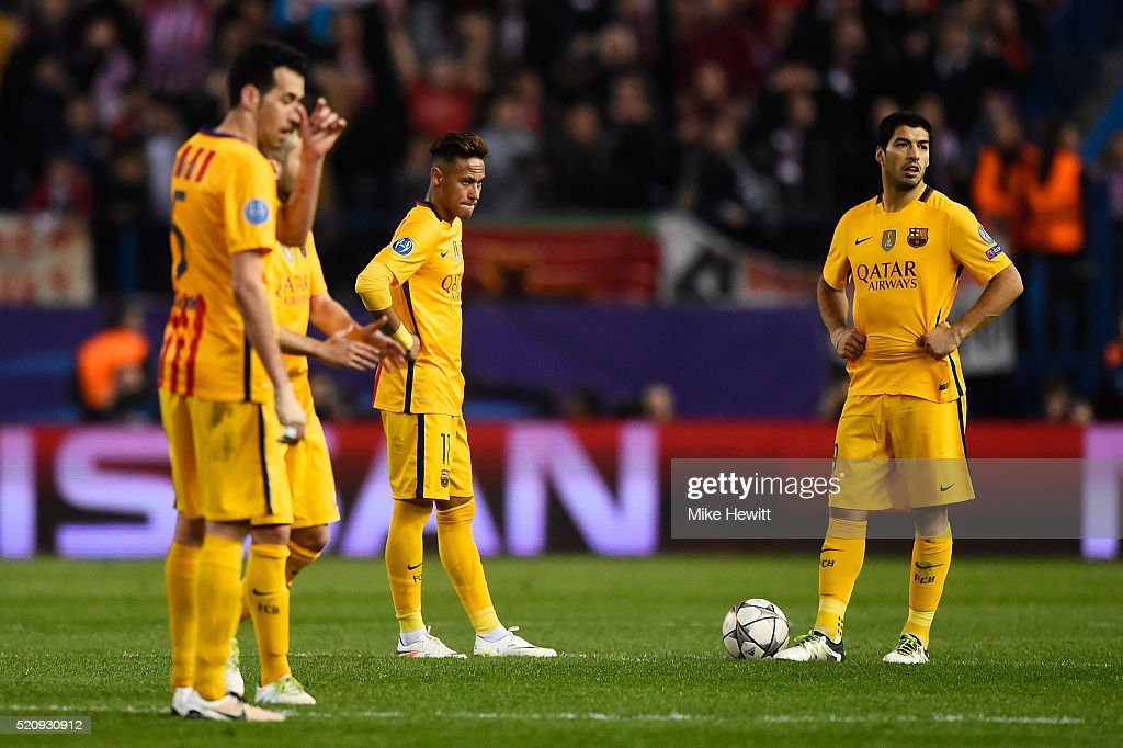 Neymar and Luis Suarez of Barcelona look dejected during the UEFA Champions League quarter final, second leg match between Club Atletico de Madrid and FC Barcelona at the Vincente Calderon on April 13, 2016 in Madrid, Spain.