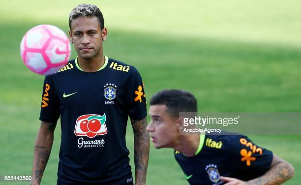 Neymar and Philippe Coutinho of Brazil is seen during a training session ahead of the FIFA 2018 World Cup Qualifying Round football match between...