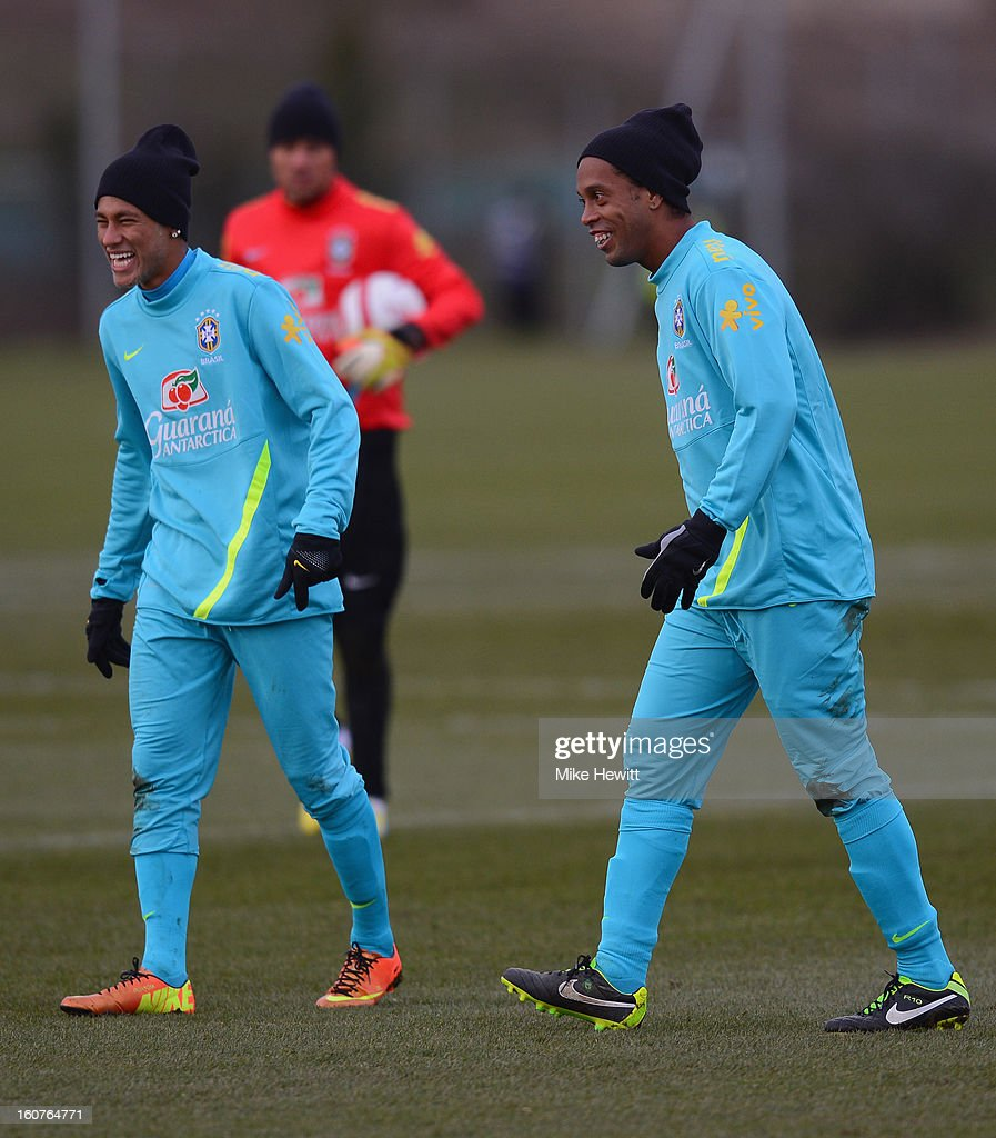 Neymar (L) and Ronaldinho of Brazil share a joke during a Brazil training session at The Hive football centre on February 5, 2013 in London, England.