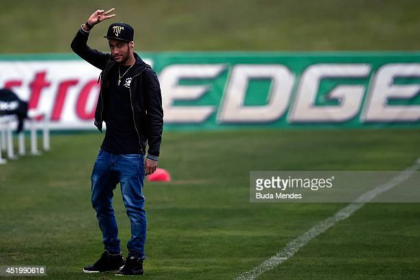 Neymar arrives during a training session of the Brazilian national football team at the squad's Granja Comary training complex on July 10 2014 in...