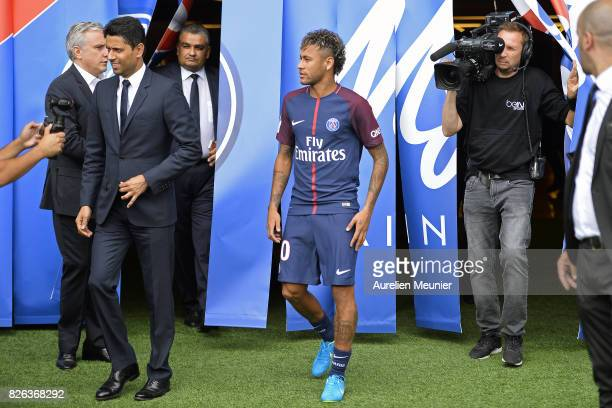 Neymar arrives to pose with his new jersey after a press conference with Paris SaintGermain President Nasser AlKhelaifi on August 4 2017 in Paris...