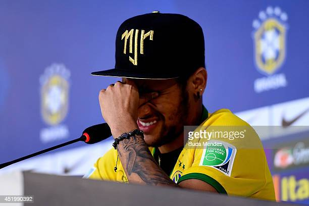 Neymar attends and speaks during a press conference on July 10 2014 in Teresopolis Brazil Neymar apparently broke down in tears as he explained to...