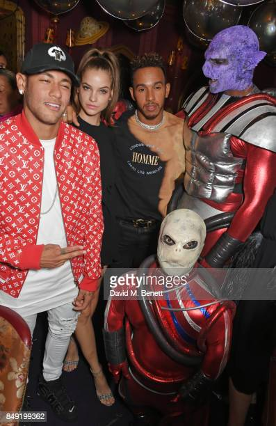 Neymar Barbara Palvin and Lewis Hamilton attend the LOVE magazine x Miu Miu party held during London Fashion Week in association with Absolut Elyx...
