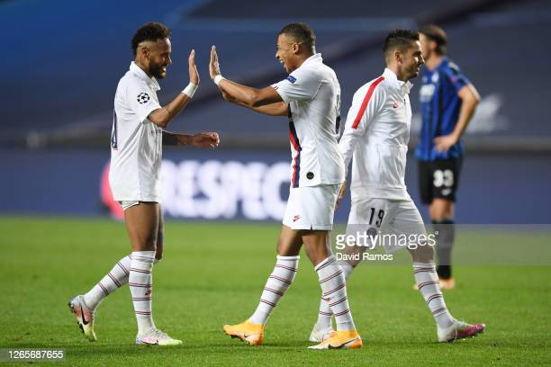Neymar celebrates victory with Kylian Mbappe of Paris SaintGermain during the UEFA Champions League Quarter Final match between Atalanta and Paris...
