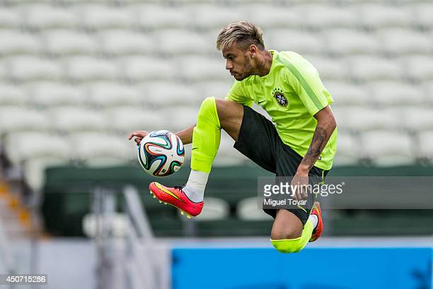 Neymar controls the ball during a Training Session at Castelao Stadium on June 16, 2014 in Fortaleza, Brazil.
