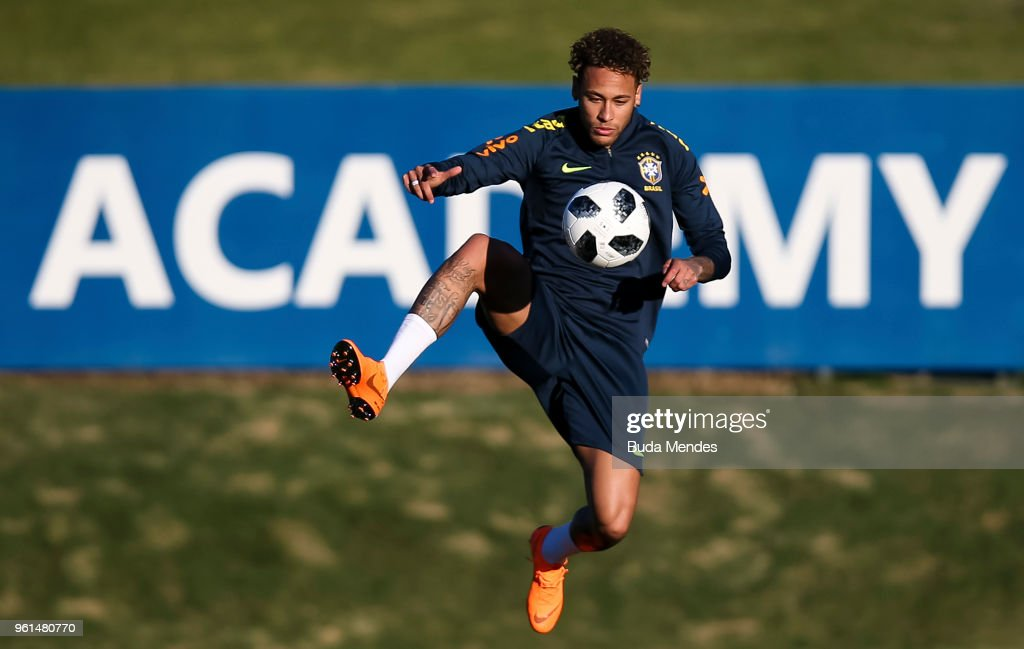 Neymar controls the ball during a training session of the Brazilian national football team at the squad's Granja Comary training complex on May 22, 2018 in Teresopolis, Brazil.