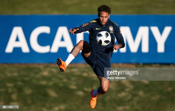 Neymar controls the ball during a training session of the Brazilian national football team at the squad's Granja Comary training complex on May 22...