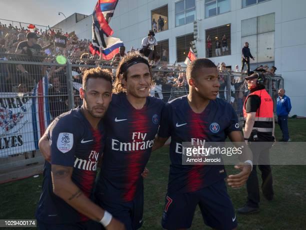 Neymar da Silva Edinson Cavani and Kylian Mbappé of Paris SaintGermain react after Kylian Mbappé score a goal during the Ligue 1 match between Paris...