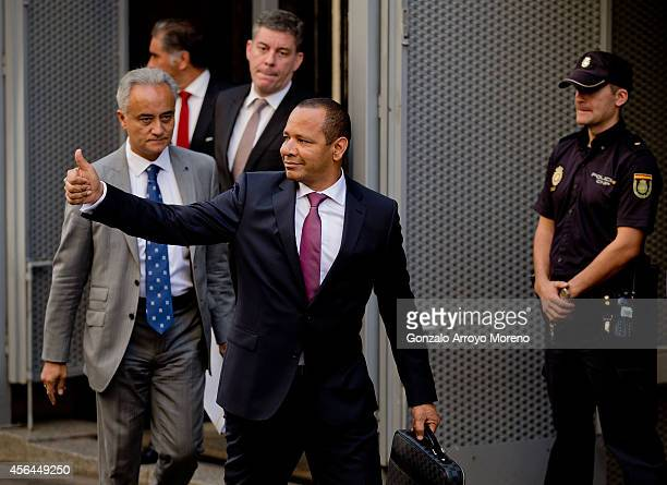 Neymar Da Silva Santos father of Brazilian FC Barcelona player Neymar JR gives the thumbs up as he leaves the Spanish Nathional Court after...