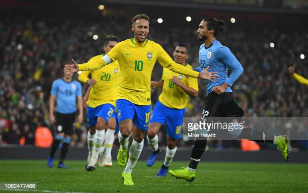 Neymar da Silva Santos Jœnior of Brazil celebrates scoring the opening goal from the spot during the International Friendly between Brazil and...