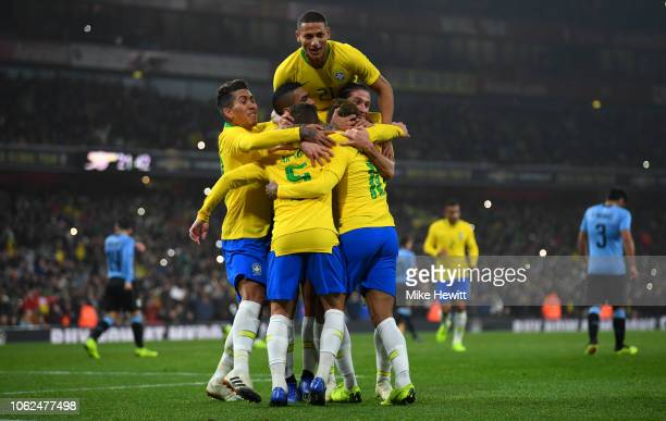 Neymar da Silva Santos Jœnior of Brazil celebrates with teammates after scoring the opening goal from the spot during the International Friendly...