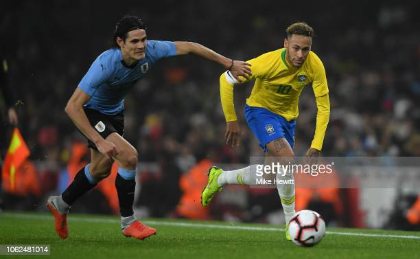 Neymar da Silva Santos Jœnior of Brazil gets past Edinson Cavani of Uruguay during the International Friendly between Brazil and Uruguay at Emirates...
