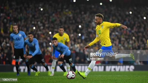 Neymar da Silva Santos Jœnior of Brazil scores the opening goal from the spot during the International Friendly between Brazil and Uruguay at...