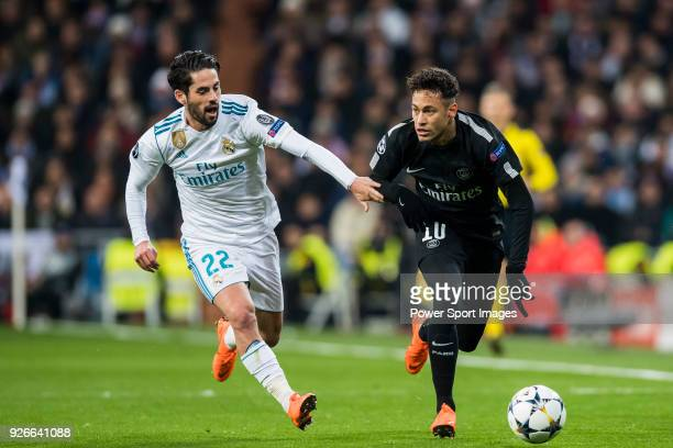 Neymar da Silva Santos Junior Neymar Jr of Paris Saint Germain competes for the ball with Isco Alarcon of Real Madrid during the UEFA Champions...