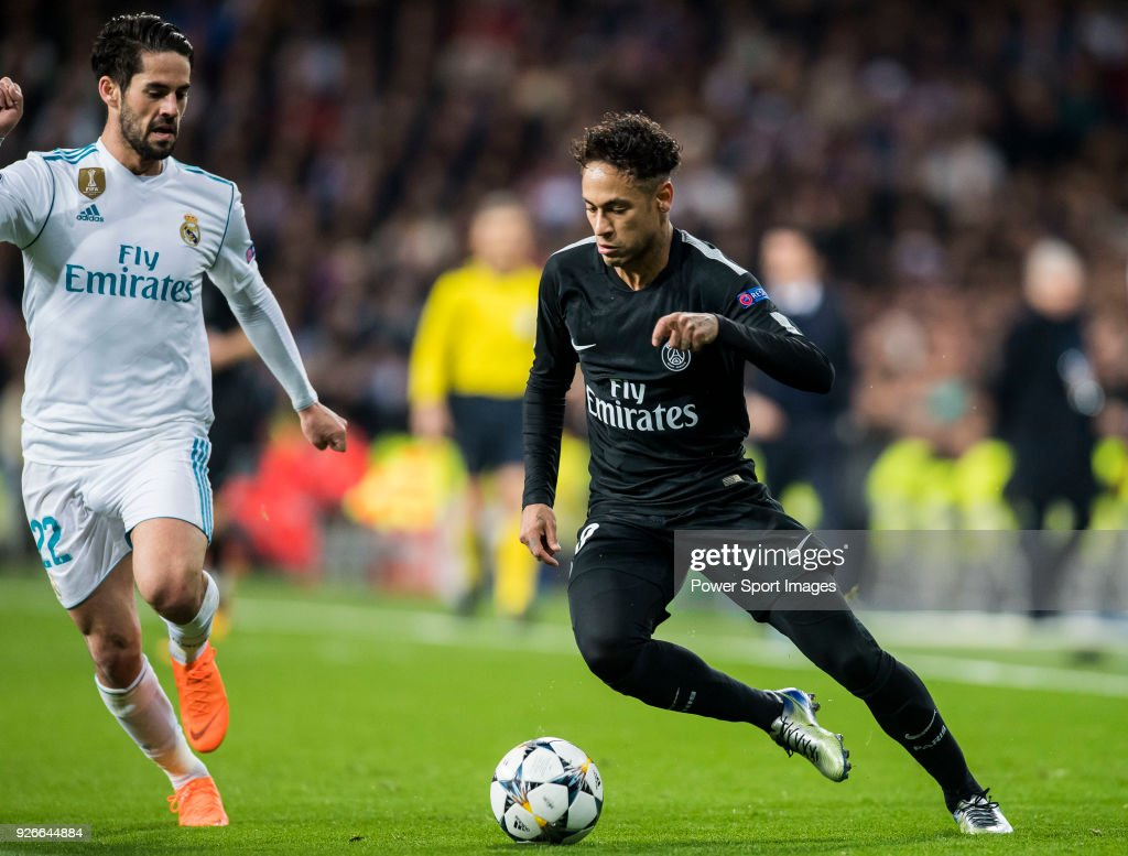 Neymar da Silva Santos Junior, Neymar Jr (R), of Paris Saint Germain battles for the ball with Isco Alarcon of Real Madrid during the UEFA Champions League 2017-18 Round of 16 (1st leg) match between Real Madrid vs Paris Saint Germain at Estadio Santiago Bernabeu on February 14 2018 in Madrid, Spain.