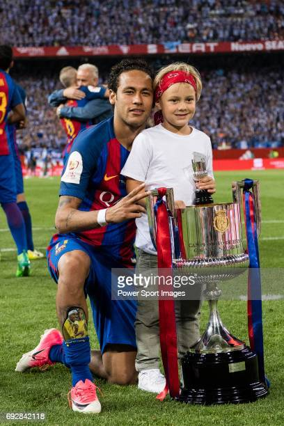 Neymar da Silva Santos Junior of FC Barcelona and his son poses for photos with the trophy after won the Copa Del Rey Final between FC Barcelona and...