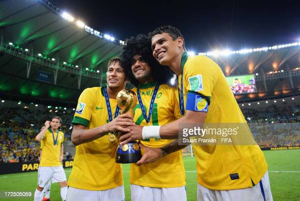 Neymar Daniel Alves and Thiago Silva of Brazil celebrate with the trophy after the FIFA Confederations Cup Brazil 2013 Final match between Brazil and...
