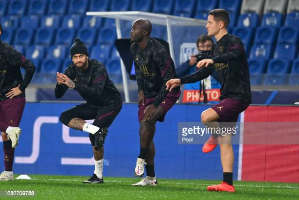 Neymar Danilo Pereira and Ander Herrera of Paris SaintGermain warms up ahead of the UEFA Champions League Group H stage match between Istanbul...