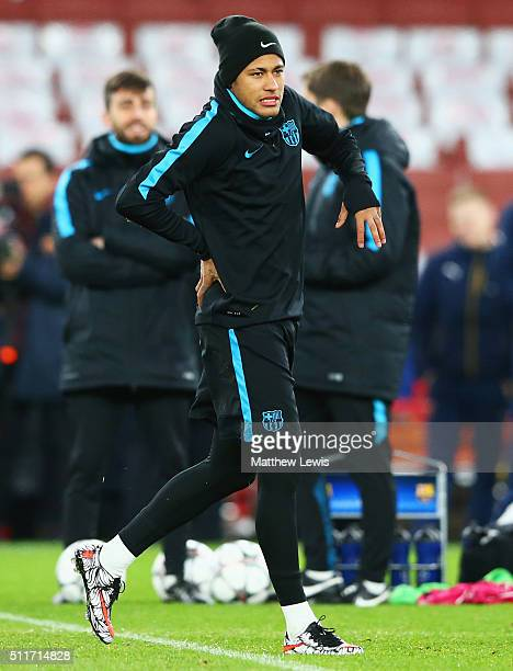 Neymar holds his back during a FC Barcelona training session ahead of their UEFA Champions League round of 16 first leg match against Arsenal at the...