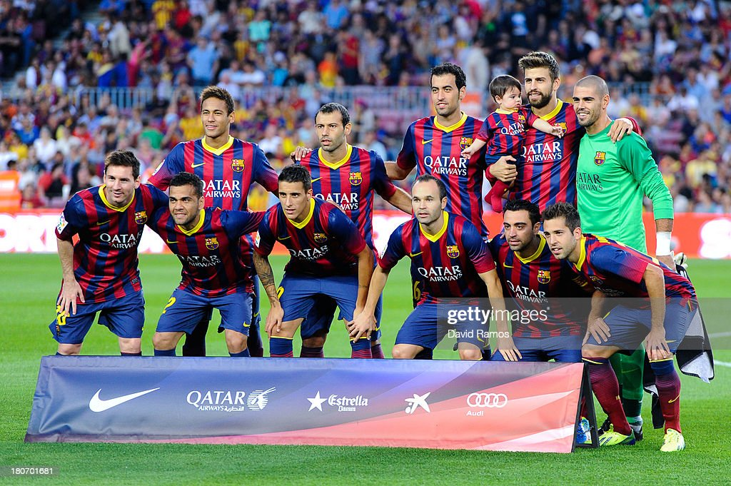 Neymar, Javier Mascherano, Sergio Busquets, Gerard Pique holding his son Milan, Victor Valdes (L-R front row) Lionel Messi, Dani Alves, Cristian Tello, Andres Iniesta, Xavi Hernandez, Jordi Alba of FC Barcelona pose for a picture prior to the La Liga match between FC Barcelona and Sevilla FC at Camp Nou on September 14, 2013 in Barcelona, Spain.