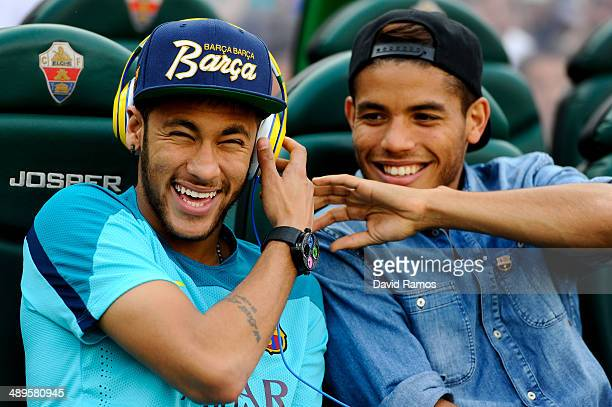 Neymar jokes with Jonathan dos Santos of FC Barcelona prior to the La Liga match between Elche FC and FC Barcelona at Estadio Manuel Martinez Valero...