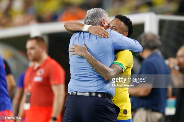 Neymar Jr. #10 of Brazil celebrates with head coach Tite after a goal against Colombia during the second half of the International Friendly soccer...
