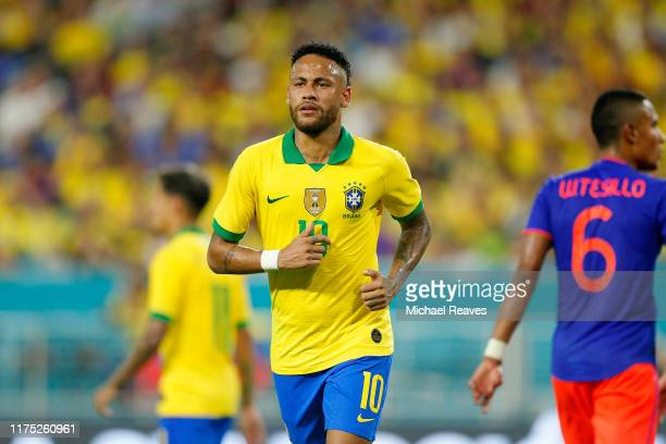 Neymar Jr. #10 of Brazil in action against Colombia during the first half of the International Friendly soccer match at Hard Rock Stadium on...