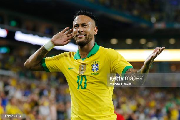 Neymar Jr #10 of Brazil reacts after assisting Casemiro on a goal against Colombia during the first half of the friendly at Hard Rock Stadium on...
