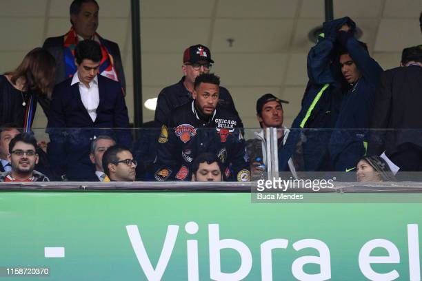Neymar Jr and Casemiro gesture from the stands during the Copa America Brazil 2019 quarterfinal match between Brazil and Paraguay at Arena do Gremio...