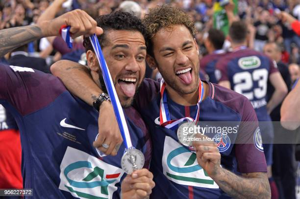 Neymar Jr and Dani Alves of Paris SaintGermain pose with their medals after the victory over Les Herbiers VF during the Coupe de France Final between...